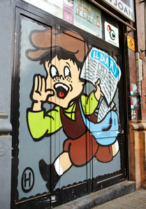 Boy runs with newspaper  graffiti