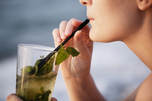 Close up of woman enjoying an evening cocktail