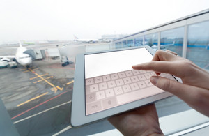 Woman with tablet computer empty screen at airport