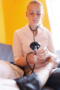 Nurse with stethoscope - blood pressure
