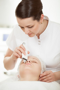 Ultrasonic facial cleaning at beauty treatment salon
