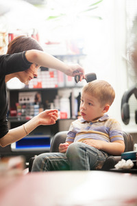 Little boy having a hair cut in salon