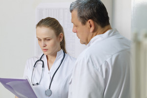 The nurse reported to doctor about medical tests