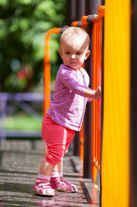 Small infant standing in playground