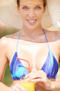 Portrait Of A Woman In Bikini And Summer Hat