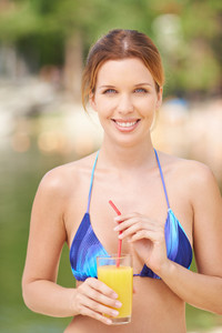 Woman Posing In Bikini And With Juice