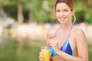 Beautiful Woman In Bikini With Glass Of Juice