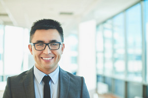 Cheerful Businessman With Toothy Smile And Eyeglasses