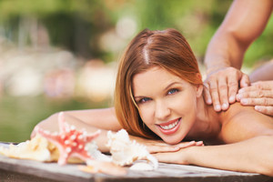 Young Female Looking At Camera While Enjoying Massage