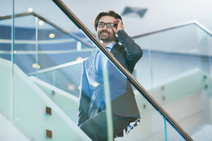 Business Leader In Elegant Suit And Eyeglasses