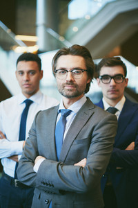 Confident Business Leader With Two Employees On Background
