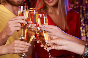 Human Hands Cheering Up With Champagne At Party