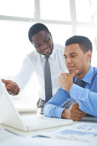 African-american Businessman Presenting His Ideas To Colleague At Meeting