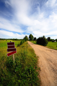Road With Blank Roadsigns And A Classic Rural Landscape