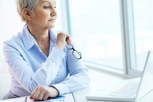 Portrait Of Mature Businesswoman Working With Laptop