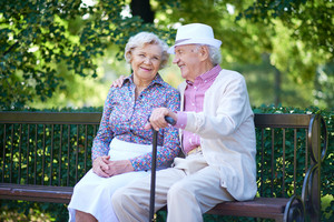 Happy Seniors Talking While Sitting In The Park