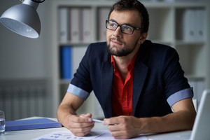 Handsome Businessman In Smart Casual And Eyeglasses Thinking Of Idea In Office