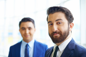 Image Of Young Businessman In Formalwear Looking At Camera On Background Of His Colleague