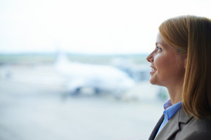 Beautiful Businesswoman Looking Through Window In Airport