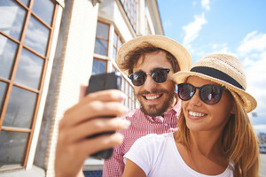 Happy Girl Making Selfie With Her Boyfriend Near By