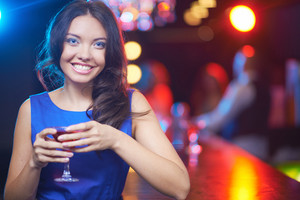 Pretty Young Girl With Martini Looking At Camera With Toothy Smile