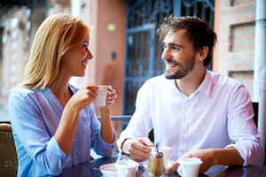 Portrait Of Affectionate Couple Having Coffee In Cafe