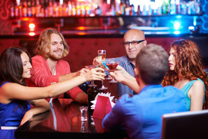 Friendly People Toasting With Alcoholic Drinks At Party
