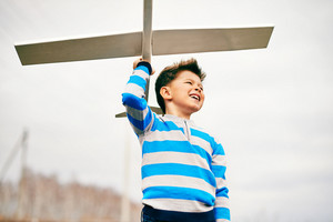 Photo Of Happy Kid With Toy Airplane Outside