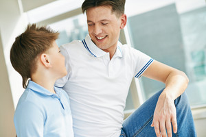 Photo Of Happy Man And His Son Looking At One Another While Talking