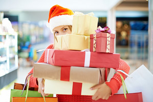 Young Woman With Heap Of Christmas Presents
