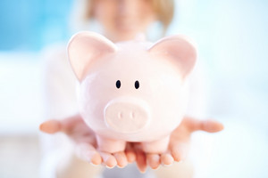 Image Of Pink Piggy Bank On Human Palms
