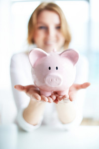 Image Of Pink Piggy Bank Held By Female
