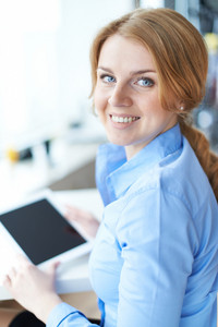 Portrait Of Pretty Businesswoman Or Student Looking At Camera With Smile