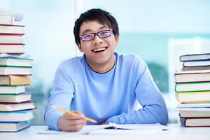 Portrait Of Successful Asian Student Sitting At Workplace