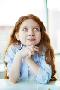 Pensive Little Girl Thinking About Something
