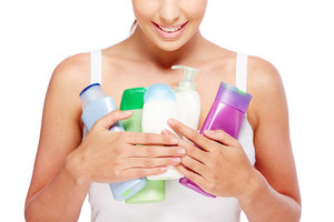 Close-up Of Young Woman Holding Containers With Shower Gel