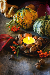 Pumpkins, Nuts And Candle