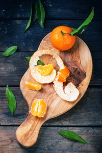 Tangerines On Cutting Board