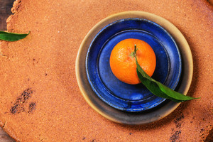 Tangerine On Blue Plate