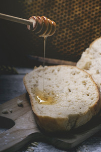 Pouring Honey On Fresh Bread
