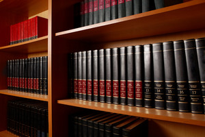 Photo Of Shelves With Books In Big Library Of Educational Institution