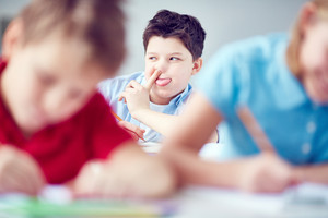 Funny Schoolboy Grimacing At Lesson
