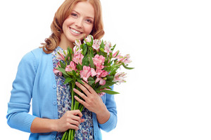 Portrait Of Smiling Female With Bunch Of Pink Lilies Looking At Camera