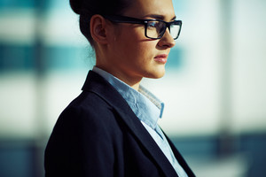 Pensive Businesswoman In Eyeglasses And Formalwear