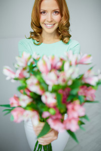 Portrait Of Lovely Lady With Bunch Of Flowers Looking At Camera