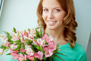 Portrait Of Pretty Girl With Bunch Of Pink Flowers