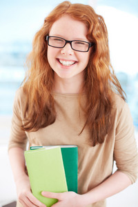 Vertical Portrait Of A Laughing Student With Wavy Red Hair