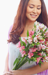 Portrait Of Charming Female With Bunch Of Fresh Flowers