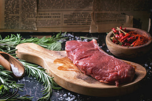 Raw Steak With Herbs And Pepper