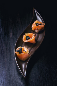 Salmon Rolls With Black Caviar